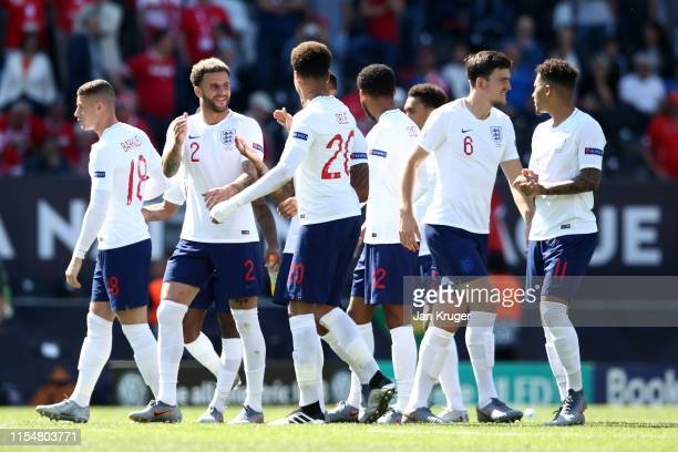 Players of England celebrate following the UEFA Nations League Third Place Playoff match between Switzerland and England at Estadio D. Afonso...