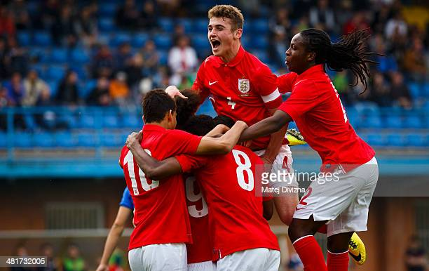 Players of England celebrate their first goal during the UEFA U17 Championship Qualifier Elite Round match between Italy and England on March 31 2014...