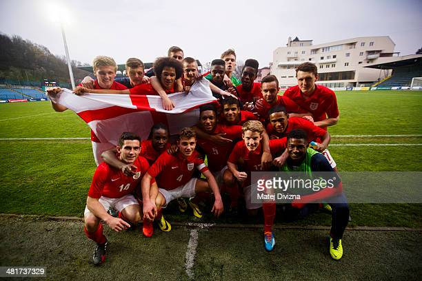 Players of England pose as they celebrate after the UEFA U17 Championship Qualifier Elite Round match between Italy and England on March 31 2014 in...