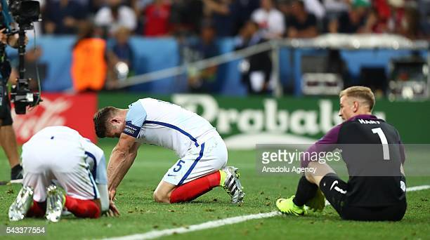 Players of England reacts after the UEFA Euro 2016 Round of 16 football match between Iceland and England at Stade de Nice in Nice France on June 27...