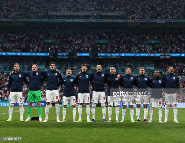 Players of England stand to sing the national anthem prior to the UEFA Euro 2020 Championship Final between Italy and England at Wembley Stadium on...