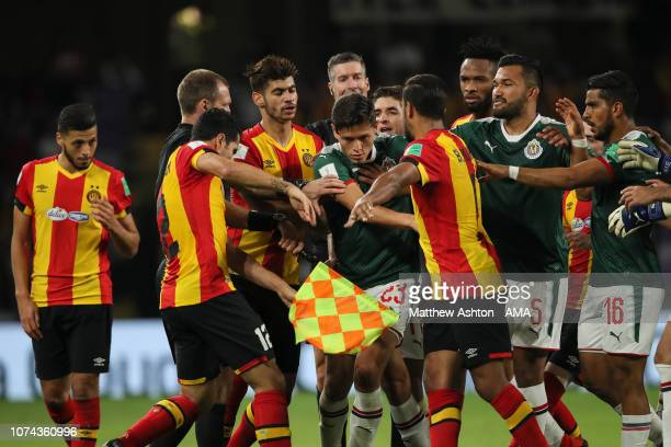 Players of ES Tunis and CD Guadalajara reacts after Anice Badri of Esperance de Tunis receives a red card during the FIFA Club World Cup UAE 2018 5th...