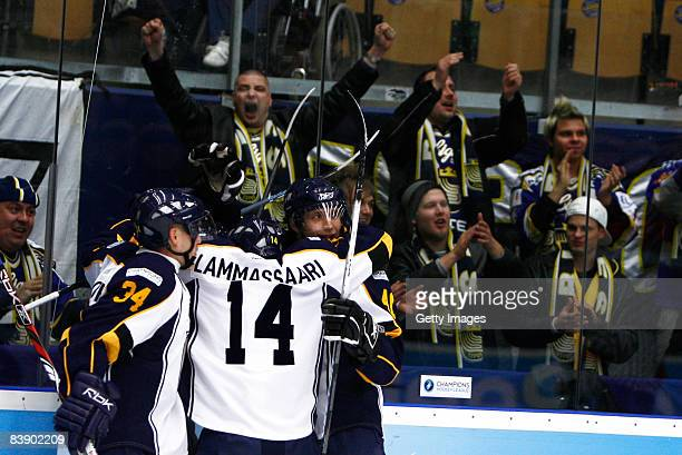 Players of Espoo Blues celebrates during the IIHF Champions Hockey League match between HV 71 Joenkoeping and Espoo Blues on December 3, 2008 in...