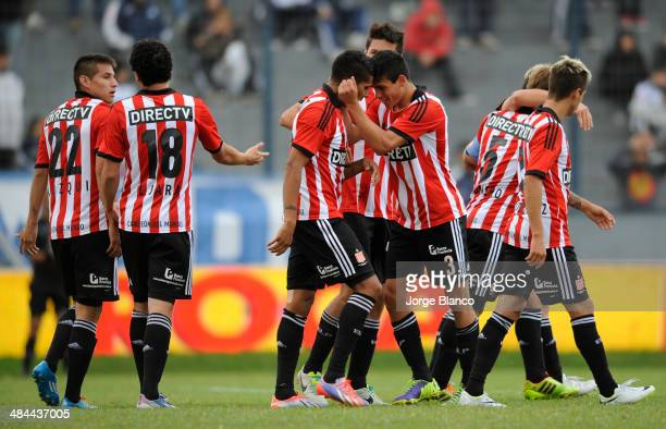 Players of Estudiantes celebrate after scoring the third goal of their team during a match between Quilmes and Estudiantes as part of 13th round of...