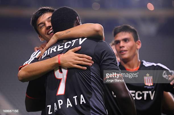Players of Estudiantes de La Plata celebrate a goal against Union de Santa Fe during a match between Estudiantes de La Plata and Union de Santa Fe as...