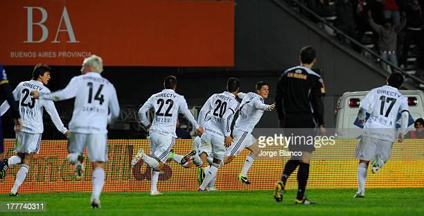 Players of Estudiantes de La Plata celebrate after scoring against Boca during a match between Estudiantes de la Plata and Boca Juniors as part of...