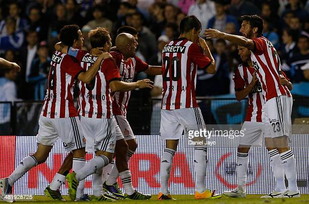 Players of Estudiantes the third goal of his team scored by Patricio Rodriguez during a match between Racing Club and Estudiantes as part of 11th...