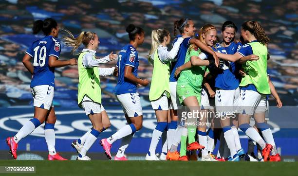 Players of Everton celebrate at full time after victory in the Women's FA Cup Quarter Final match between Everton FC and Chelsea FC at Goodison Park...