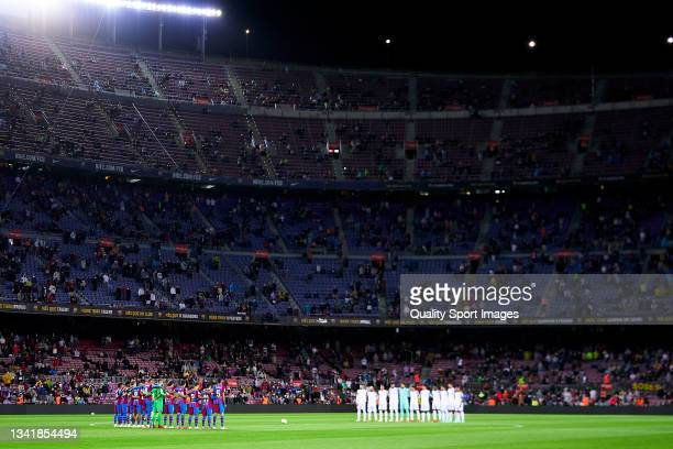 Players of FC Barcelona and players of Granada CF pays tribute with a minute of silence prior to the La Liga Santander match between FC Barcelona and...