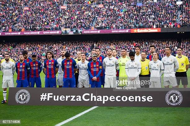 Players of FC Barcelona and Real Madrid CF and officials observe a minute of silence in memory of the victims of the plane crash involving the...