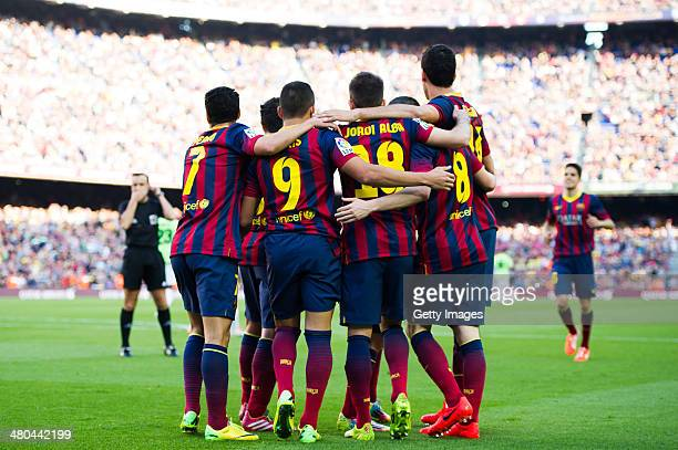 Players of FC Barcelona celebrate after Alexis Sanchez scored his team's second goal during the La Liga match between FC Barcelona and CA Osasuna at...