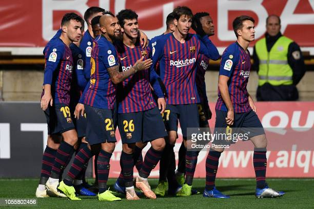 Players of FC Barcelona celebrate after Clement Lenglet scores the first goal of his team during the Spanish Copa del Rey match between Cultural...