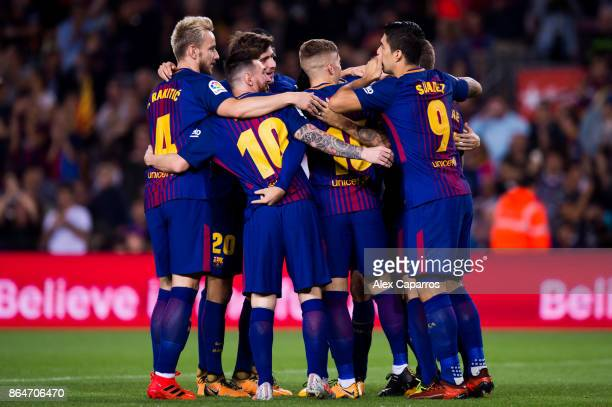 Players of FC Barcelona celebrate after their teammate Gerard Deulofeu scored the opening goal during the La Liga match between Barcelona and Malaga...