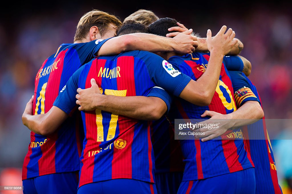 Players of FC Barcelona celebrate after their teammate Luis Suarez scored his team's sixth goal during the La Liga match between FC Barcelona and Real Betis Balompie at Camp Nou on August 20, 2016 in Barcelona, Spain.