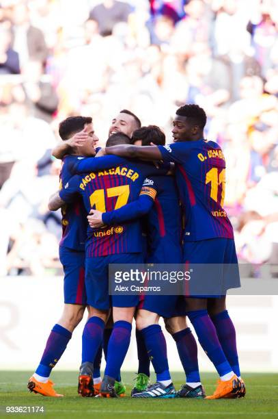 Players of FC Barcelona celebrate after their teammate Paco Alcacer scored the opening goal during the La Liga match between Barcelona and Athletic...