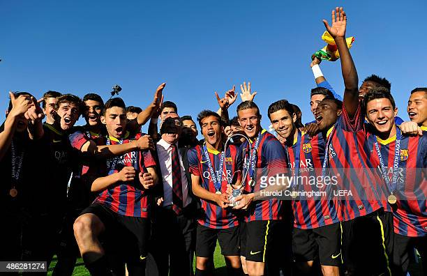 Players of FC Barcelona celebrate their victory during the final ceremony of the UEFA Youth League Final match between SL Benfica and FC Barcelona at...