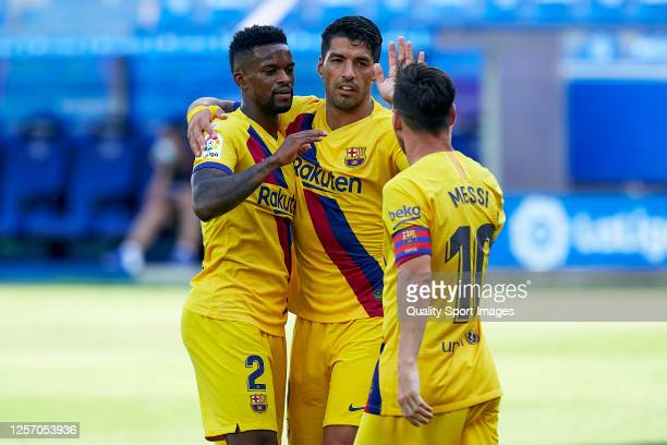Players of FC Barcelona celebrating their team's fourth goal during the Liga match between Deportivo Alaves and FC Barcelona at Estadio de...
