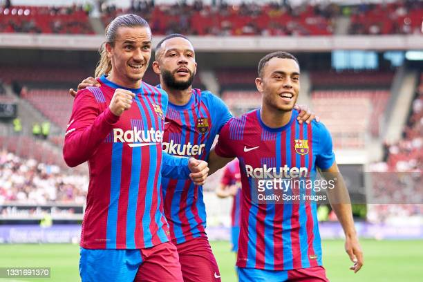 Players of FC Barcelona celebrating their team's second goal during a pre-season friendly match between VfB Stuttgart and FC Barcelona at...