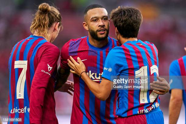 Players of FC Barcelona celebrating their team's third goal during a pre-season friendly match between VfB Stuttgart and FC Barcelona at...