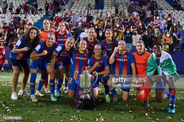 Players of FC Barcelona celebrating with trophy during the Copa de la Reina Final match between Levante UD and FC Barcelona at Estadio Municipal de...