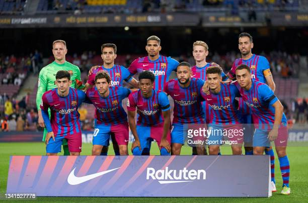 Players of FC Barcelona line up for a team photo prior to the La Liga Santander match between FC Barcelona and Granada CF at Camp Nou on September...