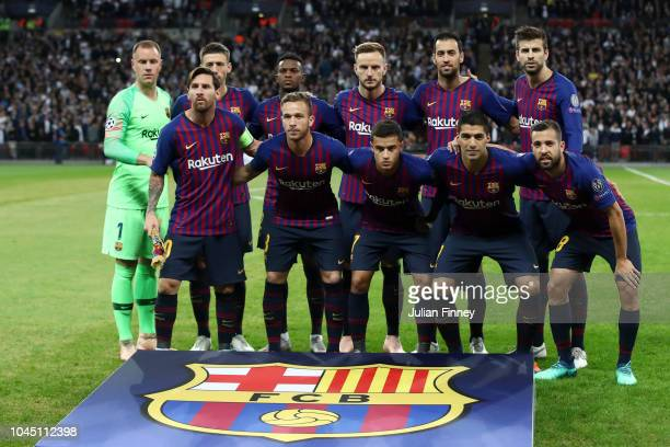 Players of FC Barcelona pose for a team photo during the Group B match of the UEFA Champions League between Tottenham Hotspur and FC Barcelona at...