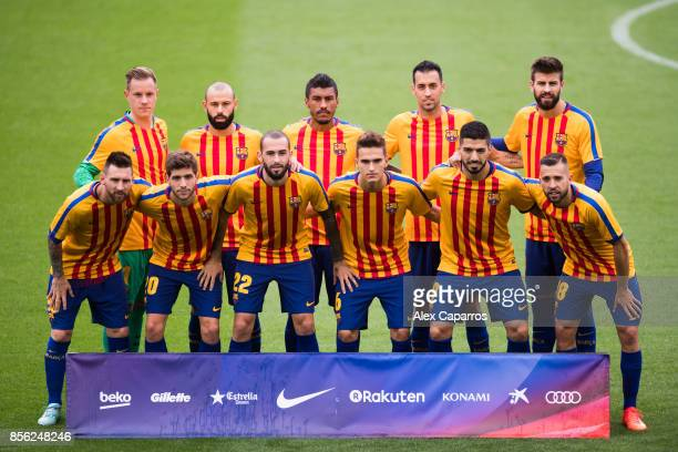 Players of FC Barcelona pose for a team photo wearing shirts in the colours of the Catalan flag prior to kickoff during the La Liga match between...