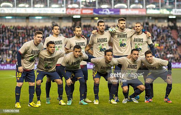 Players of FC Barcelona pose with a jersey in support to their coach Tito Vilanova at the begining of the La Liga game between Real Valladolid and FC...