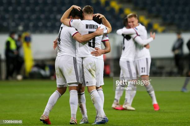 Players of FC Basel celebrate during the UEFA Europa League round of 16 first leg match between Eintracht Frankfurt and FC Basel at Commerzbank Arena...