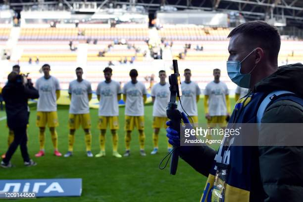 Players of FC BATE and FC Rukh attend the Belarus Championship football match between FC BATE and FC Rukh in the town of Borisov, some 70 km east of...