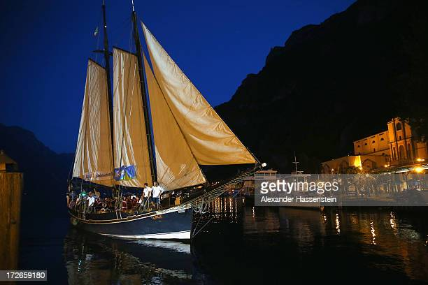 Players of FC Bayern Muenchen arrive with a ship for a reception at Riva del Garda port on July 4 2013 in Riva del Garda Italy
