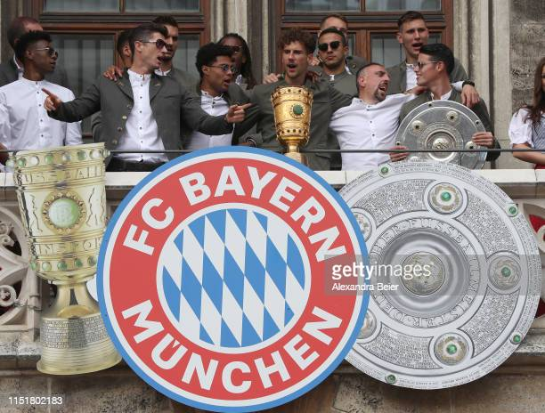 Players of FC Bayern Muenchen celebrate winning the Bundesliga title and the German Cup title for the season 2018/19 on the balcony of the town hall...
