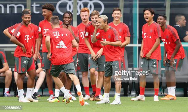 Players of FC Bayern Muenchen joke during a training session ahead of the team's friendly match aganst Manchester City on Saturday during the FC...