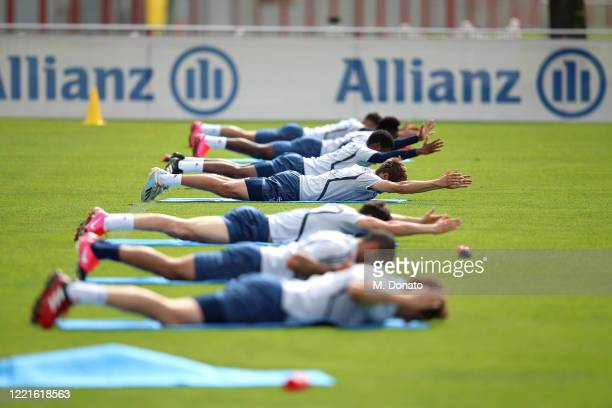 Players of FC Bayern Muenchen strech during a training session at Saebener Strasse training ground on April 28 2020 in Munich Germany