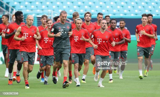 Players of FC Bayern Muenchen warm up during a training session ahead of the team's friendly match aganst Manchester City on Saturday during the FC...