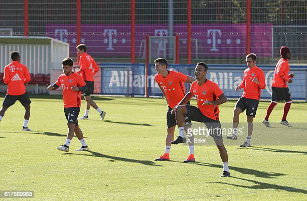 Players of FC Bayern Muenchen warm up during a training session at the club's Saebener Strasse training ground on October 24 2016 in Munich Germany