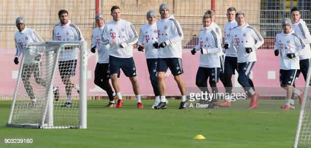Players of FC Bayern Muenchen warm up during a training session at the club's Saebener Strasse training ground on January 10 2018 in Munich Germany