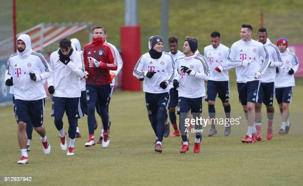 Players of FC Bayern Muenchen warm up during a training session at the club's Saebener Strasse training ground on February 1 2018 in Munich Germany
