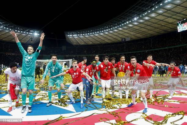 Players of FC Bayern Munich celebrates with the trophy after the German DFB Cup final soccer match between FC Bayern Munich and RB Leipzig at the...