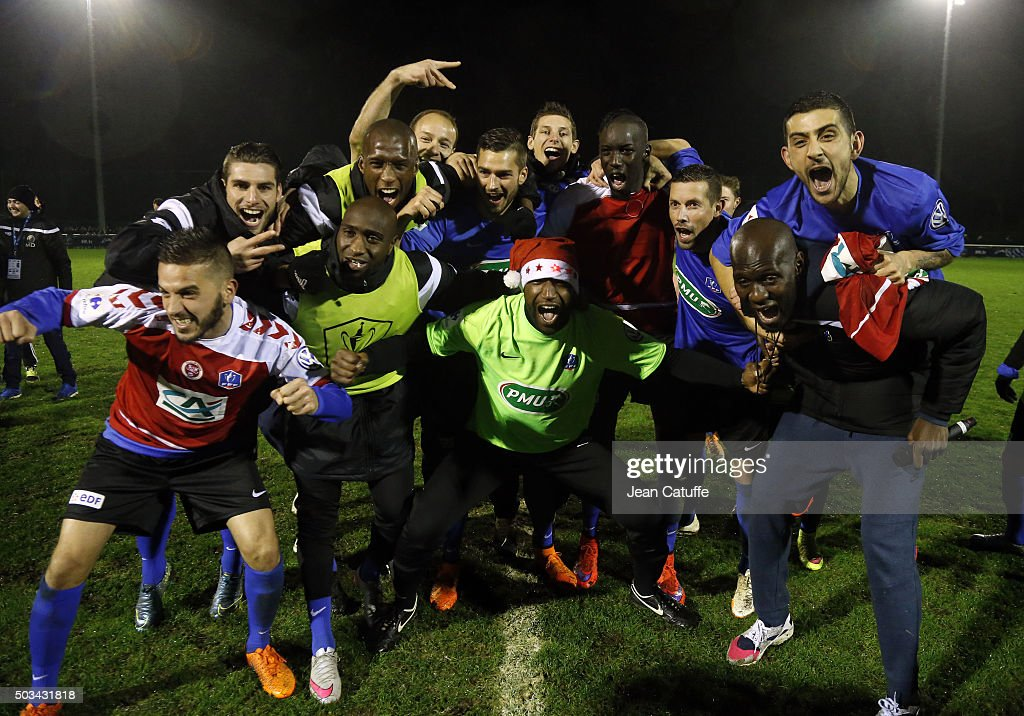 Players of FC Chambly (National) celebrate their victory 4-1 against Stade de Reims (Ligue 1) following the French Cup match at Stade des Marais on January 2, 2016 in Chambly, France.