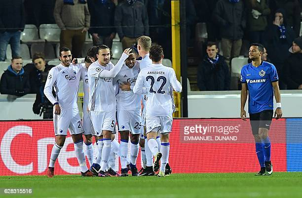 Players of FC Copenhagen celebrate after Bruges' Brandon Mechele scored an own goal during the UEFA Champions League football match Bruges vs...