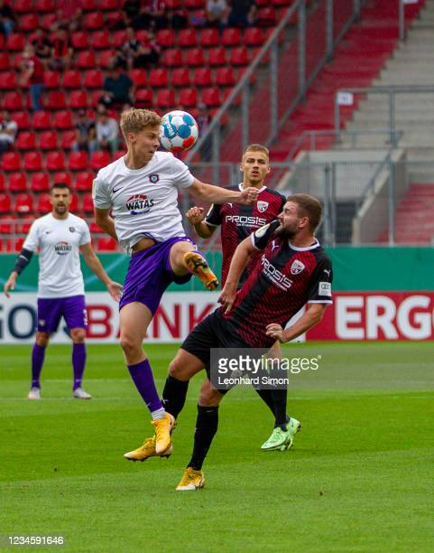 Players of FC Ingolstadt 04 and Erzgebirge Aue in action during the DFB Cup first round match between FC Ingolstadt 04 and Erzgebirge Aue at Audi...