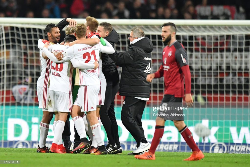 Players of FC Ingolstadt 04 celebrate after the final whistle during the Second Bundesliga match between 1. FC Nuernberg and FC Ingolstadt 04 at Max-Morlock-Stadion on November 6, 2017 in Nuremberg, Germany.