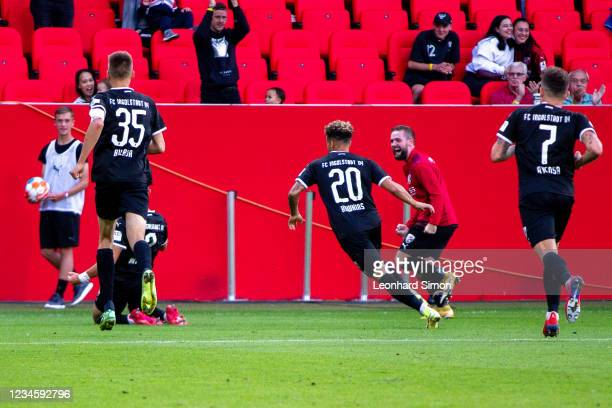 Players of FC Ingolstadt 04 celebrate scoring the 2:1 during the DFB Cup first round match between FC Ingolstadt 04 and Erzgebirge Aue at Audi...