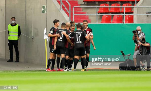 Players of FC Ingolstadt 04 celebrate the first goal during the DFB Cup first round match between FC Ingolstadt 04 and Erzgebirge Aue at Audi...