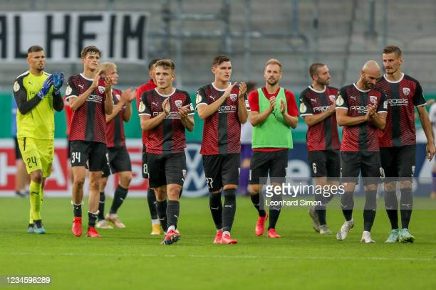 Players of FC Ingolstadt celebrate their victory over Erzgebirge Aue after the DFB Cup first round match between FC Ingolstadt 04 and Erzgebirge Aue...
