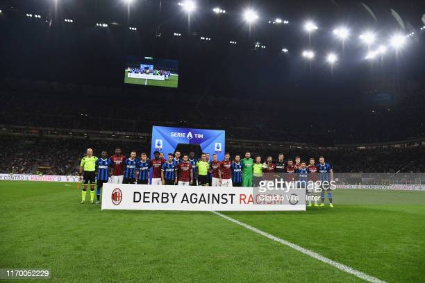 Players of FC Internazionale and players of AC Milan pose for derby against racism line up prior to the Serie A match between AC Milan and FC...