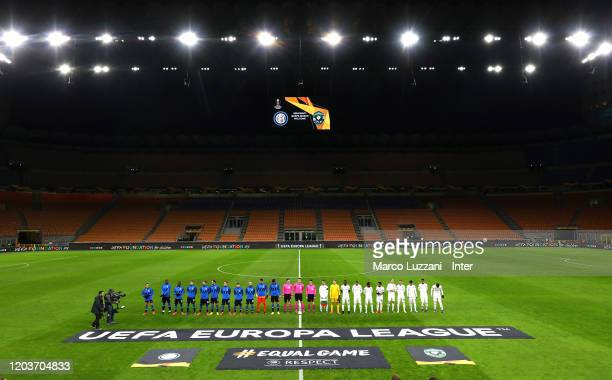 Players of FC Internazionale and players of PFC Ludogorets Razgrad line up prior to the UEFA Europa League round of 32 second leg match between FC...