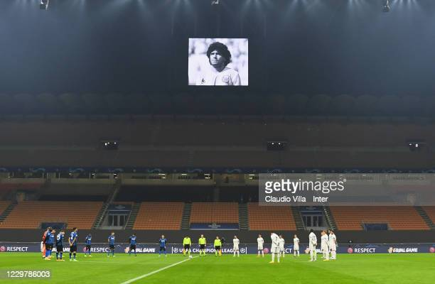 Players of FC Internazionale and players of Real Madrid hold a minute of silence in tribute to Diego Maradona before the UEFA Champions League Group...