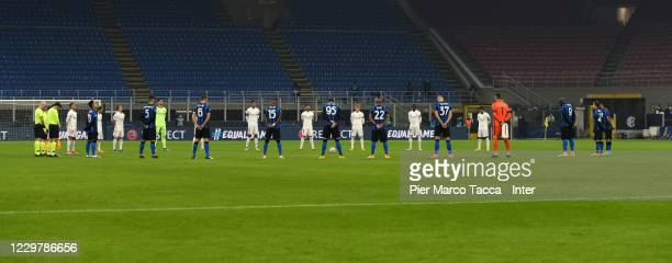 Players of FC Internazionale and players of Real Madrid respect a minute's silence in tribute to Diego Maradona before the UEFA Champions League...